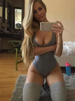 Sexy curved blonde doing a selfie