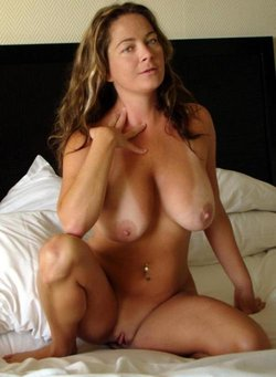 Amateur busty MILF presents huge tits
