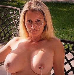 Blonde beauty with big tits and pierced nipples