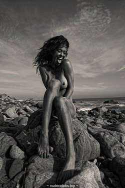 Brooke Burke topless on a beach black-&-white photoshoot