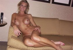 Naked MILF exposes big tits