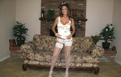 Beautiful brunette Charley S remves her red bra t sun her sexy big bbs