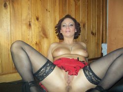 Mature lady in black stockings shows her pussy lying on the floor