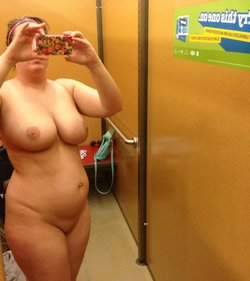 Amateur fat wife bares her big boobs during self shot in dressing room