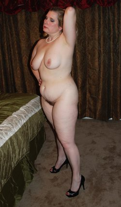 Chubby wife shows her curvy body posing only in high heels