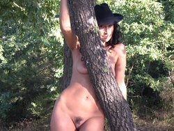 Beautiful brunette wife showing off her sexy body outdoor