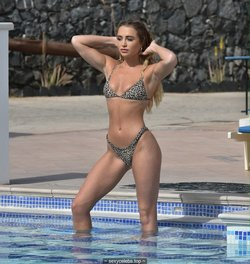 Georgia Harrison poolside in leopard print bikini in Tenerife