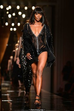 Naomi Campbell walks the runway during Versace Show